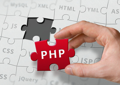 Hand Of Programmer Holds Puzzle With PHP Programming Language Written.